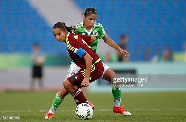Jacqueline Ovalle of Mexico challenges Deyna Castellanos of Venezuela during the FIFA U17 Women's World Cup Quarter Final match between Mexico and...