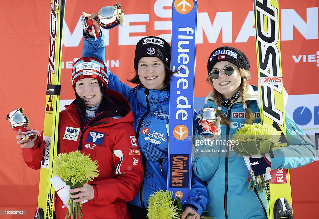 Jacqueline Seifriedsberger of Austria, Colin Mattel of France, Anette Sagen of Norway pose on the podium during day one of the FIS Women's Ski Jumping World Cup at Miyanomori Jump Stadium on February 2, 2013 in Sapporo, Japan.
