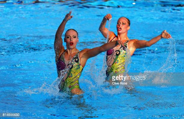 Jacqueline Simoneau and Claudia Holzner of Canada competes during the Womens Synchronised Duet Technical Preliminary roundon day one of the Budapest...