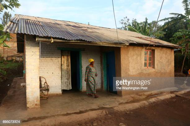 Jacqueline who declined to let us use her first or last name walks out of the house that she shares with her mother in Ngoma Sector Rwanda in the...