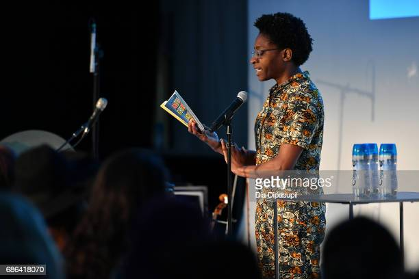 Jacqueline Woodson does a reading on stage during the Feminist as F*ck with Amber Tamblyn and Roxane Gay panel during the 2017 Vulture Festival at...