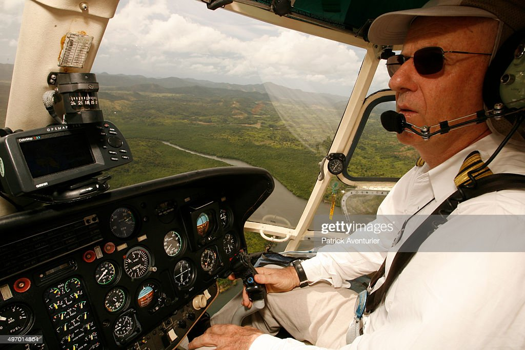 Jacques Branellec piloting a helicopter on his way to inspect one of his company's pearl farms in Palawan, 500km from Manila, where he lives. Jacques Branellec is a director and co-founder of pearl production company Jewelmer International, set up in 1979, which has six pearl oyster farms in the Philippines. They specialize in production of golden pearls, and are the only company in the world able to produce them. Each pearl takes 5 years to grow, under very carefully controlled conditions, and can fetch huge sums of money when developed to perfection.