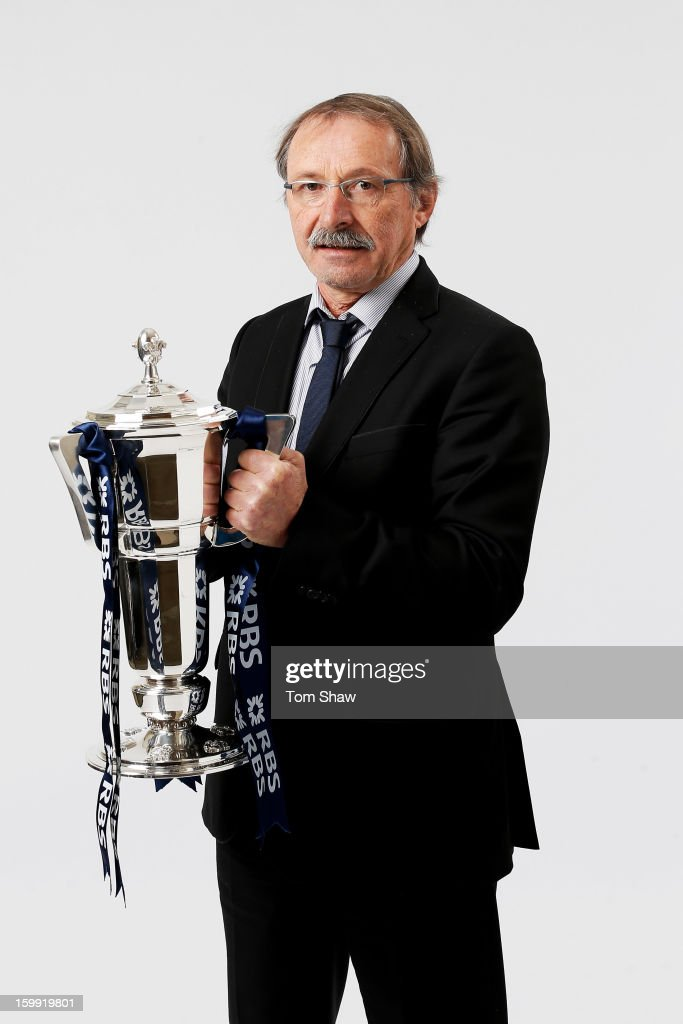 Jacques Brunel the Italy head coach poses with the Six Nations trophy during the RBS Six Nations launch at The Hurlingham Club on January 23, 2013 in London, England.