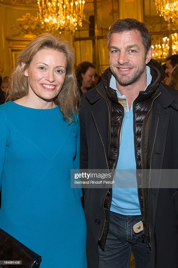 Jacques Bungert, CEO Courreges (R), and Nathalie Boy de La Tour attend the benefit party in aid of the 'Chirurgie Plus' (AC+) association at Hotel Meurice on March 24, 2013 in Paris, France.