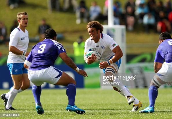Jacques Burger of Namibia is challenged by Anthony Perenise of Samoa during the IRB 2011 Rugby World Cup Pool D match between Samoa and Namibia at...