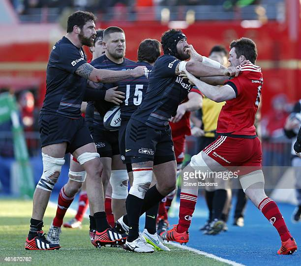 Jacques Burger of Saracens and Peter O'Mahony of Munster confront each other during the European Rugby Champions Cup pool one match between Saracens...