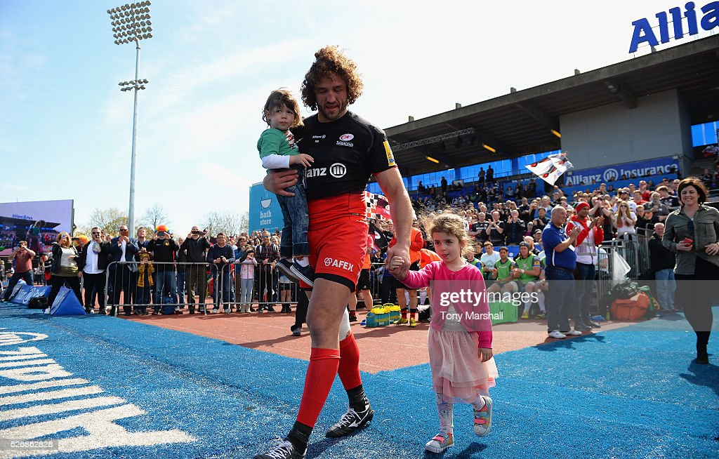 Jacques Burger of Saracens walks out with his children before the start of the Aviva Premiership match between Saracens and Newcastle Falcons at Allianz Park on May 1, 2016 in Barnet, England.