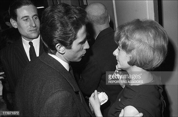 Jacques Chazot and Francoise Sagan at the premier of 'Happiness Odd and pass' in Paris France on January 17 1964