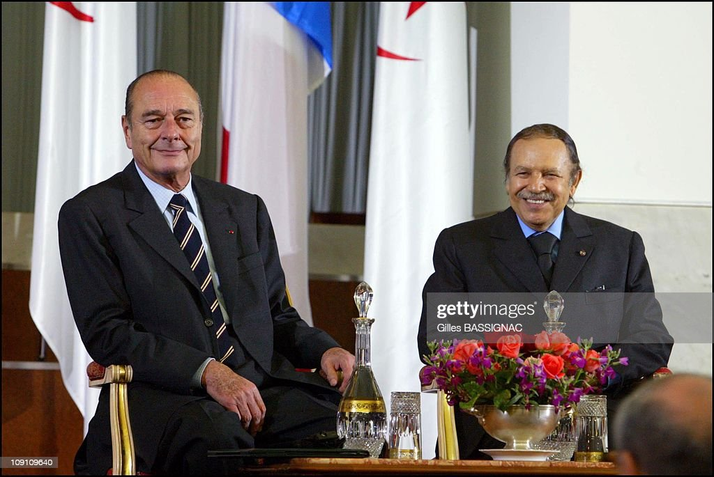 <a gi-track='captionPersonalityLinkClicked' href=/galleries/search?phrase=Jacques+Chirac&family=editorial&specificpeople=165237 ng-click='$event.stopPropagation()'>Jacques Chirac</a> At The Algerian Parliament On March 3Rd, 2003 In Algiers, Algeria. With President <a gi-track='captionPersonalityLinkClicked' href=/galleries/search?phrase=Abdelaziz+Bouteflika&family=editorial&specificpeople=176720 ng-click='$event.stopPropagation()'>Abdelaziz Bouteflika</a>