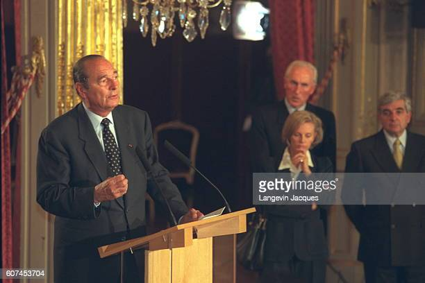 Jacques Chirac gives a speech before Louis Le Pensec Elisabeth Guigou JeanPierre Chevenement