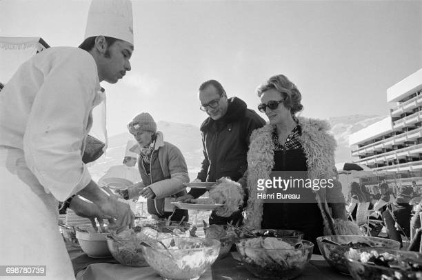 Jacques Chirac his wife Bernadette and daughter Laurence having lunch in Les Menuires France during their first holiday in 6 years 26th December 1976