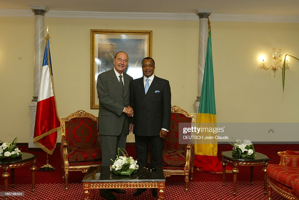 <a gi-track='captionPersonalityLinkClicked' href=/galleries/search?phrase=Jacques+Chirac&family=editorial&specificpeople=165237 ng-click='$event.stopPropagation()'>Jacques Chirac</a> In Congo For The 2nd Summit Of Heads Of State And Government For The Conservation And Management Of Forest Ecosystems In Central Africa. Le président français Jacques CHIRAC et son homologue congolais Denis SASSOU NGUESSO se serrant la main au palais présidentiel, à Brazzaville..