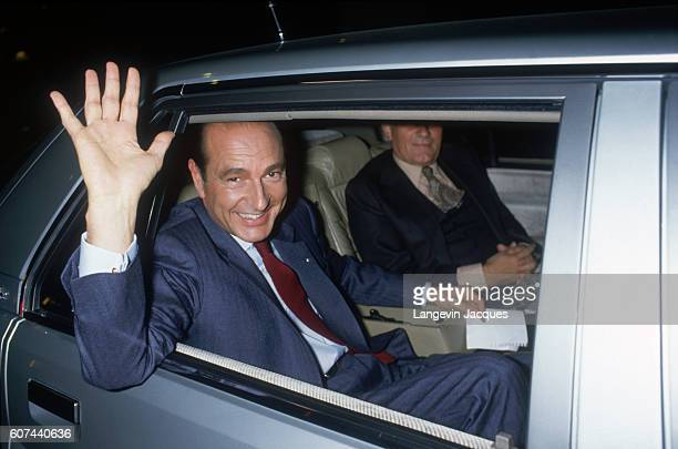 Jacques Chirac leaves the TF1 television studio in Paris after a televised debate with his adversary Prime Minister Laurent Fabius