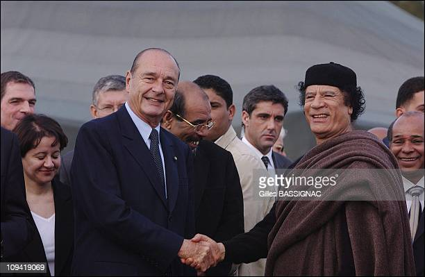 Jacques Chirac meets with Muammar Gaddafi on a visit to Libya in 2004
