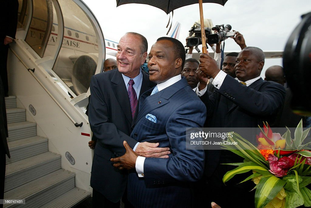 <a gi-track='captionPersonalityLinkClicked' href=/galleries/search?phrase=Jacques+Chirac&family=editorial&specificpeople=165237 ng-click='$event.stopPropagation()'>Jacques Chirac</a> Official Travel In Black Africa: Congo. Jacques CHIRAC accueilli à sa descente d'avion par le président congolais Denis SASSOU NGUESSO à BRAZZAVILLE.