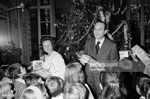 Jacques Chirac the French Prime Minister and his wife Bernadette handing out Christmas presents to children at to the Matignon Christmas fundraiser...