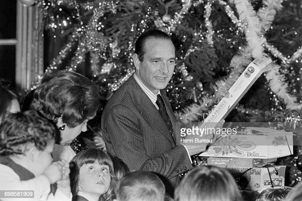 Jacques Chirac the French Prime Minister handing out Christmas presents to children at to the Matignon Christmas fundraiser Paris 8th December 1974