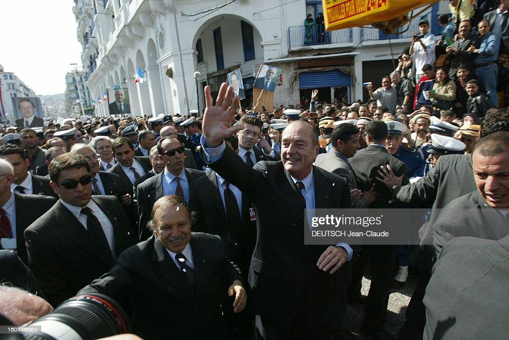 <a gi-track='captionPersonalityLinkClicked' href=/galleries/search?phrase=Jacques+Chirac&family=editorial&specificpeople=165237 ng-click='$event.stopPropagation()'>Jacques Chirac</a> Visit In Algeria. Une pluie de confettis s'abattant sur le cortège officiel avec en tête, Jacques CHIRAC saluant la foule marchant aux côtés d'Abdelaziz BOUTEFLIKA allant de la place Mauritania à la Wilaya d'ALGER, tous deux emportés par un fleuve humain.