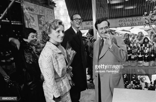 Jacques Chirac visiting a market in Place Maubert during his campaign to be elected Mayor of Paris France 24th February 1977 With him are his wife...
