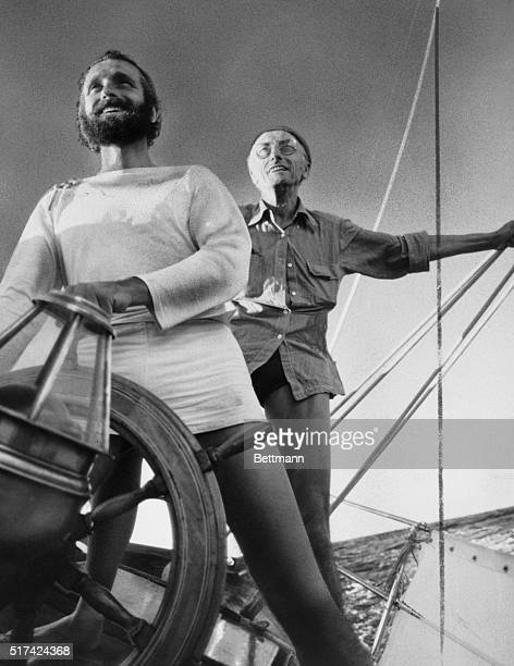 Jacques Cousteau background and his son Phillipe at the wheel of a ship