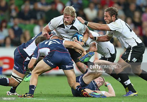 Jacques Engelbrecht of the Kings is tackled during the round nine Super Rugby match between the Rebels and the Kings at AAMI Park on April 13 2013 in...