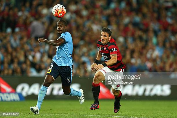 Jacques Faty of Sydney FC and Federico Piovaccari of the Wanderers chase the ball during the round three ALeague match between Sydney FC and Western...
