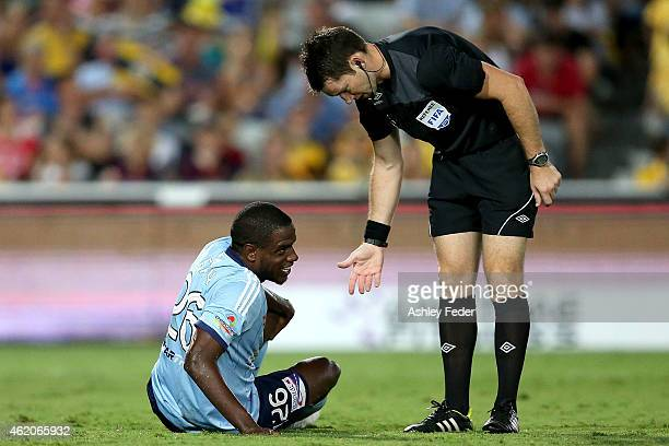 Jacques Faty of Sydney FC is helped up by Referee Jarred Gillett during the round 16 ALeague match between the Central Coast Mariners and Sydney FC...