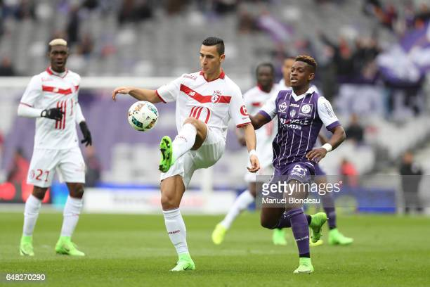 Jacques Francois Moubandje of Toulouse and Anwar El Ghazi of Lille during the French Ligue 1 match between Toulouse and Lille at Stadium Municipal on...