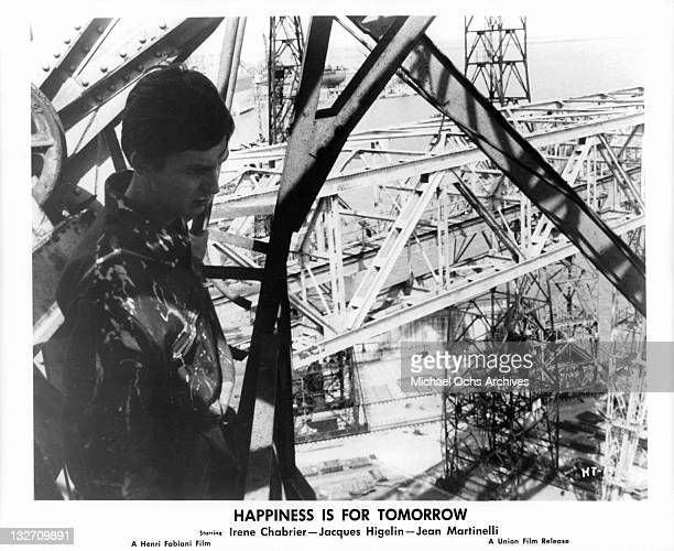 Jacques Higelin high above ground looking down in a scene from the film 'Happiness Is For Tomorrow' 1961