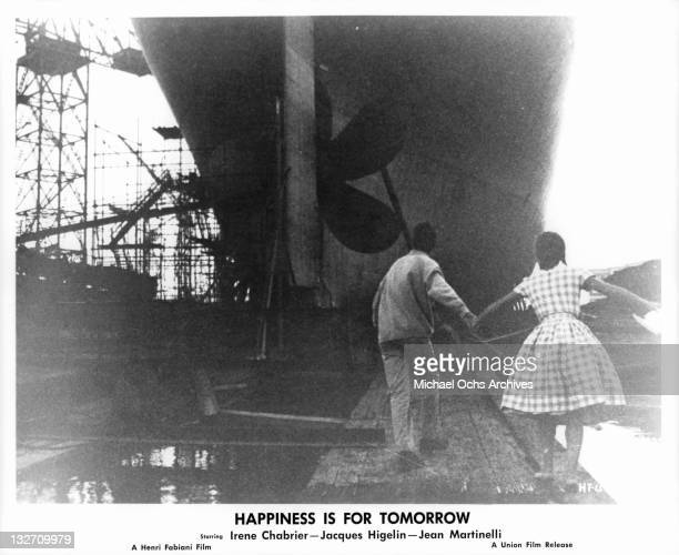 Jacques Higelin leading Irene Chabrier to hull of ship in a scene from the film 'Happiness Is For Tomorrow' 1961