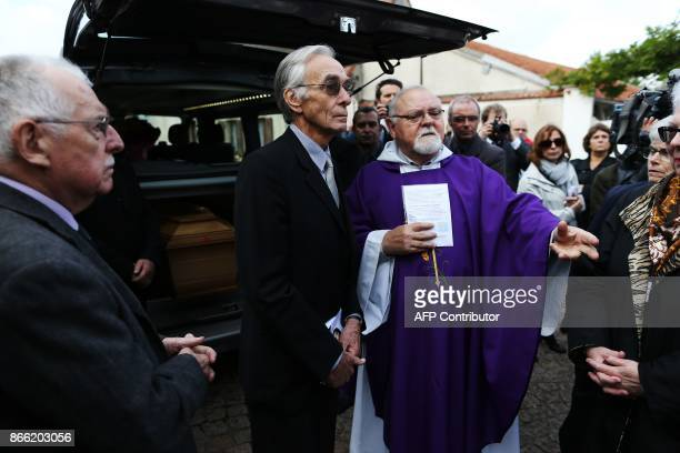 Jacques Jenvrin the companion of the late French actress Danielle Darrieux stands with a priest as he attends her funeral service with others in...