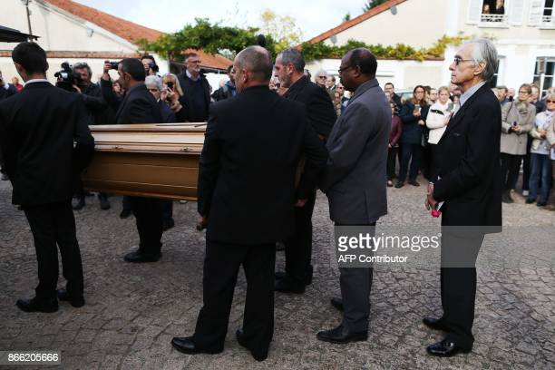 Jacques Jenvrin the companion of the late French actress Danielle Darrieux stands behind her coffin as he attends her funeral service with others in...