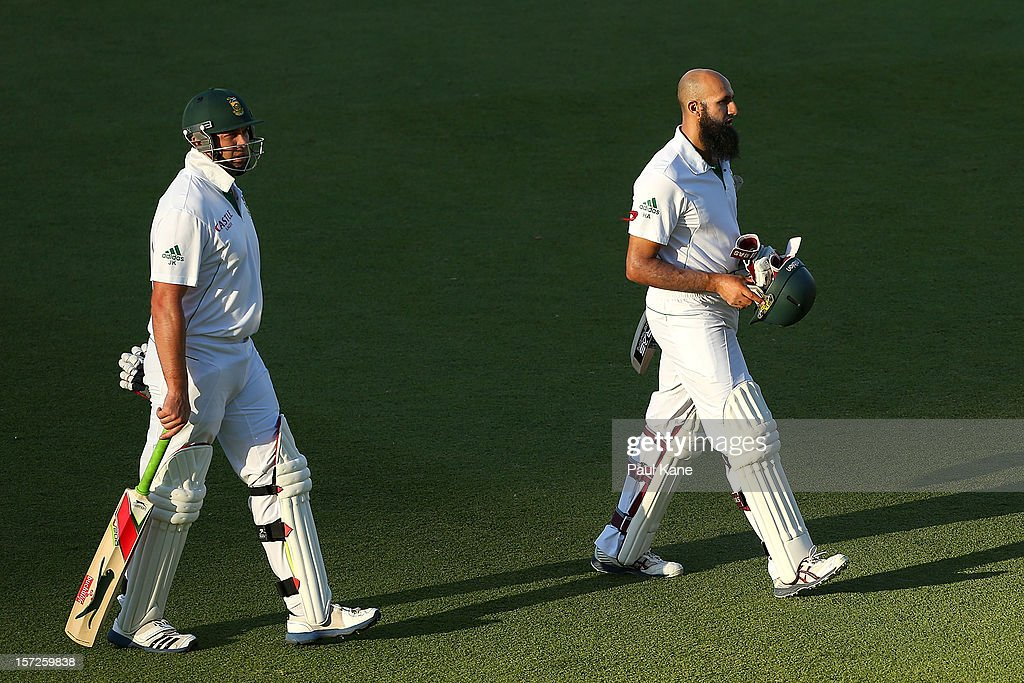<a gi-track='captionPersonalityLinkClicked' href=/galleries/search?phrase=Jacques+Kallis&family=editorial&specificpeople=184509 ng-click='$event.stopPropagation()'>Jacques Kallis</a> and <a gi-track='captionPersonalityLinkClicked' href=/galleries/search?phrase=Hashim+Amla&family=editorial&specificpeople=647392 ng-click='$event.stopPropagation()'>Hashim Amla</a> leave the field at the end of days play during day two of the Third Test Match between Australia and South Africa at WACA on December 1, 2012 in Perth, Australia.