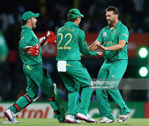 Jacques Kallis of South Africa is congratulated on the wicket of Virat Kohli of India after he was caught by AB de Villiers during the ICC World...