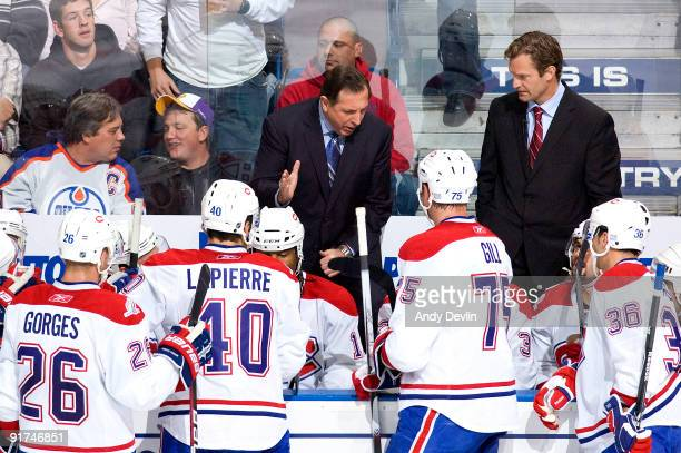 Jacques Martin head coach for the Montreal Canadiens talks to his team after going fown 30 in the second period against the Edmonton Oilers on...