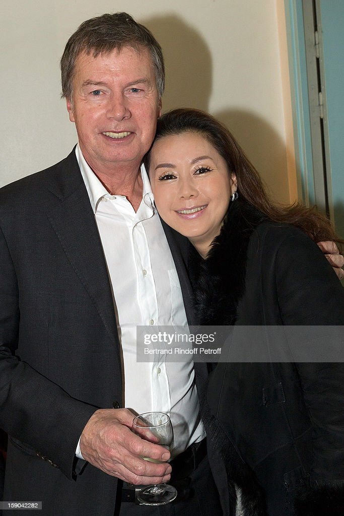Jacques Mollet (L), Senior Vice-President Samsung Europe, and guest pose after attending the show of French impersonator Laurent Gerra at Olympia hall on January 5, 2013 in Paris, France.