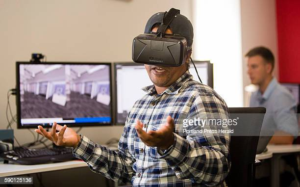 Jacques Pena Senior Visualizer/Digital Artist of Tangram 3DS interactive media company of Kittery Maine wears a virtual reality headset and talks...