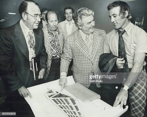 Jacques Plante former Leaf goalie and now coachgeneral manager of Quebec Nordiques of World Hockey Association looks at plans for sports complex...
