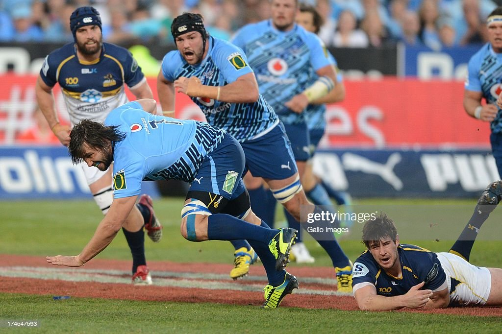 Jacques Potgieter of the Bulls breaks through a tackle during the SupeRugby semi final match between Vodacom Bulls and Brumbies from Loftus Versfeld Stadium on July 27, 2013 in Pretoria, South Africa.
