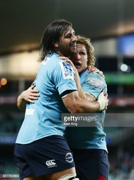 Jacques Potgieter of the Waratahs celebrates with Michael Hooper after scoring a try during the round 18 Super Rugby match between the Waratahs and...