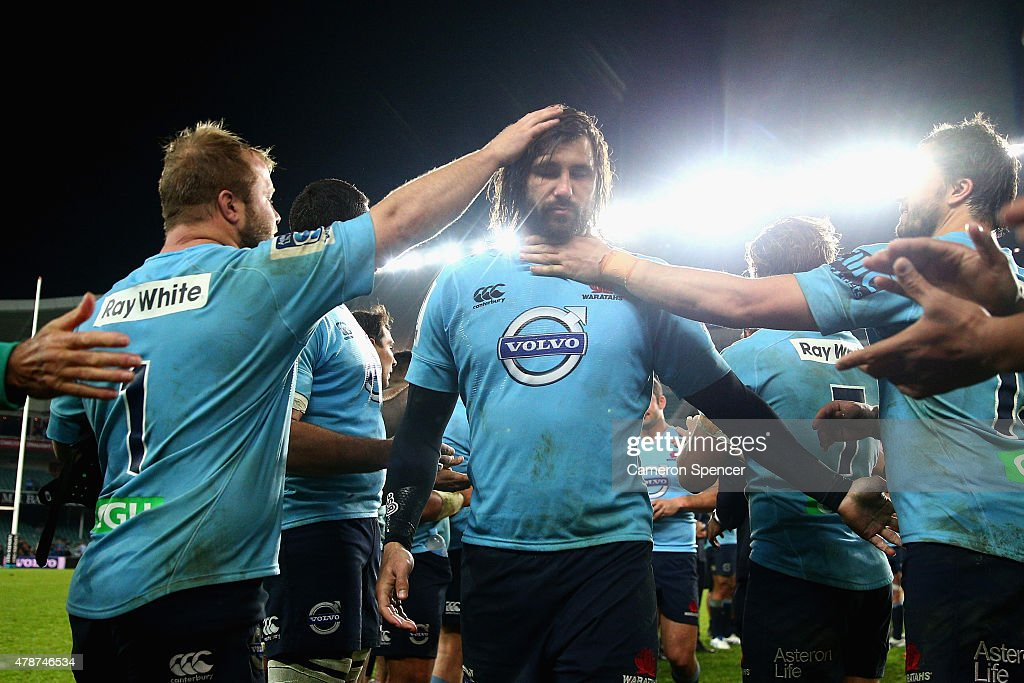 Jacques Potgieter of the Waratahs is clapped off the field by team mates after the Super Rugby Semi Final match between the Waratahs and the Highlanders at Allianz Stadium on June 27, 2015 in Sydney, Australia.