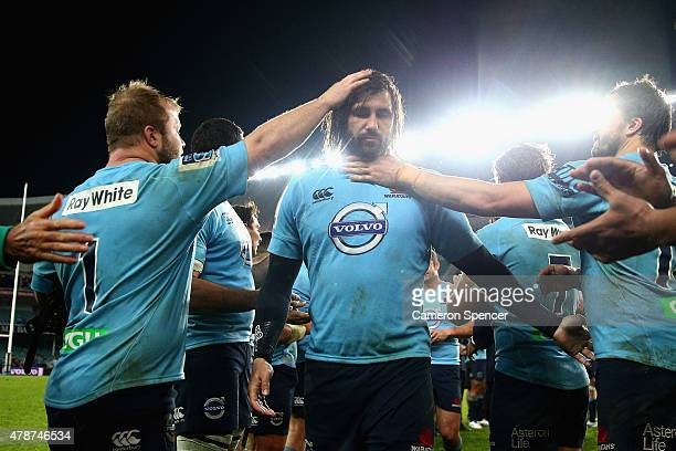 Jacques Potgieter of the Waratahs is clapped off the field by team mates after the Super Rugby Semi Final match between the Waratahs and the...