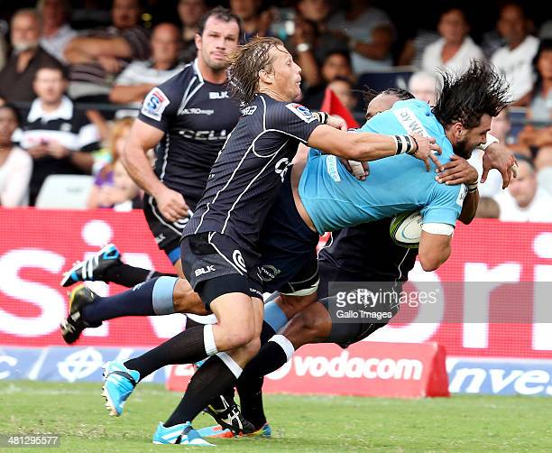 Jacques Potgieter of the Waratahs on the attack is tackled by Charl McLeod of the Cell C Sharks during the Super Rugby Rd 7 match between Cell C...
