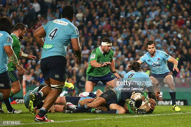 Jacques Potgieter of the Waratahs tackles Patrick Osborne of the Highlanders high as he attempts to score a try during the Super Rugby Semi Final...