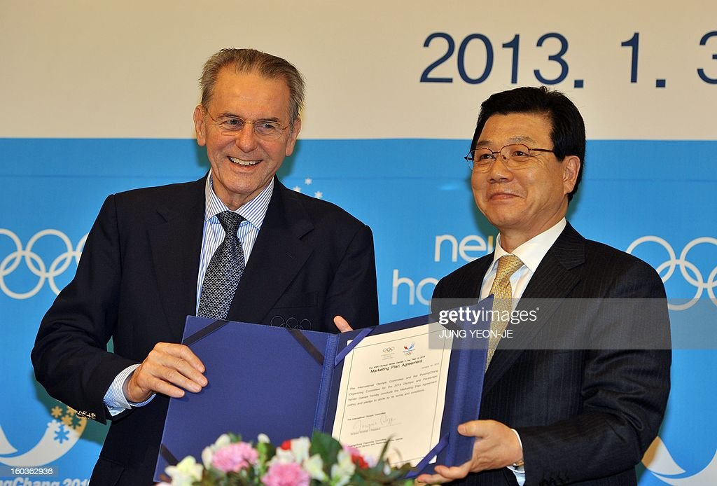 Jacques Rogge (L), president of the International Olympic Committee (IOC), poses with Kim Jin-Sun (R), head of the Organizing Committee for the 2018 Winter Olympics in Pyeongchang, during a signing ceremony of the Marketing Plan Agreement in Seoul on January 30, 2013. The Pyeongchang Organizing Committee and the IOC signed an agreement on January 30, for the implementation of the marketing program for the South Korean alpine town.