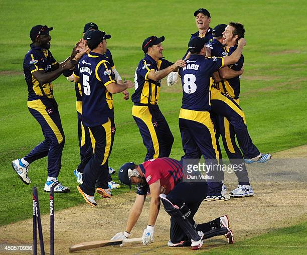 Jacques Rudolph of Glamorgan is congratulated by his team mates after running out Doug Bollinger of Kent on the last ball to tie the game during the...