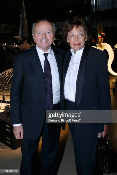 Jacques Toubon and his wife Lise pose in front the works of JeanPaul Goude during the 'Societe des Amis du Musee d'Art Moderne du Centre Pompidou'...