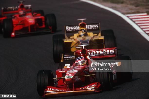 Jacques Villeneuve Damon Hill Michael Schumacher WilliamsMecachrome FW20 JordanMugenHonda 198 Ferrari F300 Grand Prix of Japan Suzuka 01 November...