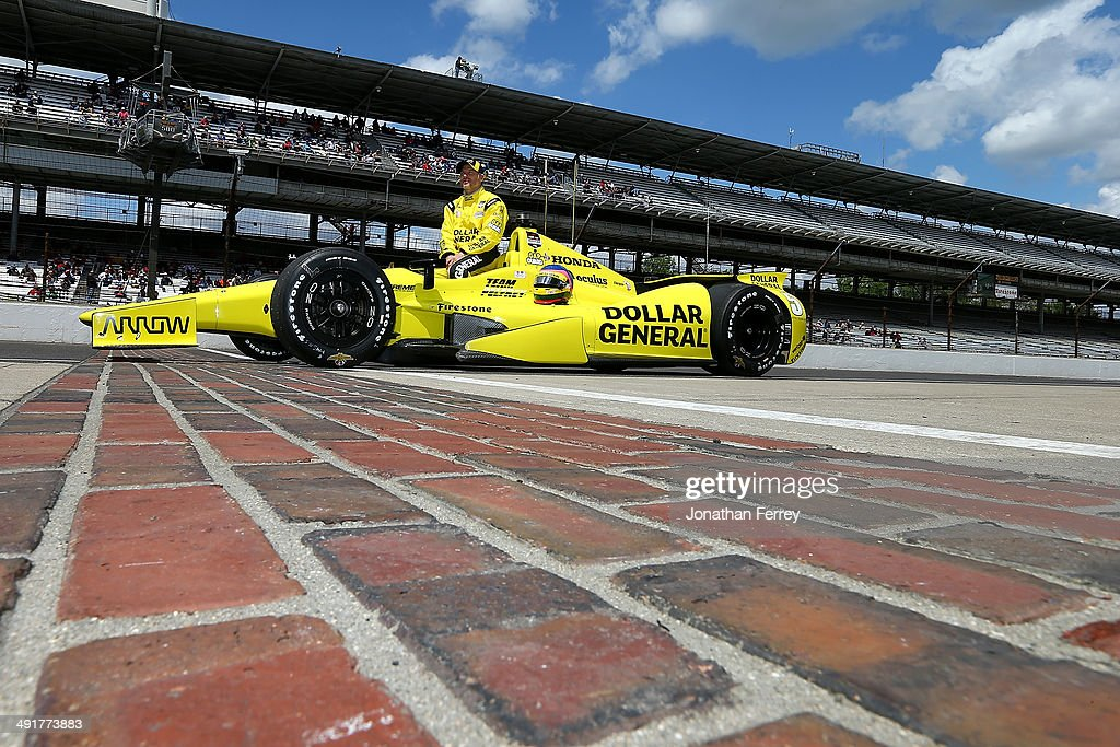 Jacques Villeneuve of Canada, driver of the #5 Dollar General Schmidt Peterson Motorsports Honda Dallara poses for a photo for after qualifying for during qualifying for the 98th Indianapolis 500 Mile Race on May 17, 2014 at the Indianapolis Motor Speedway in Indianapolis, Indiana.