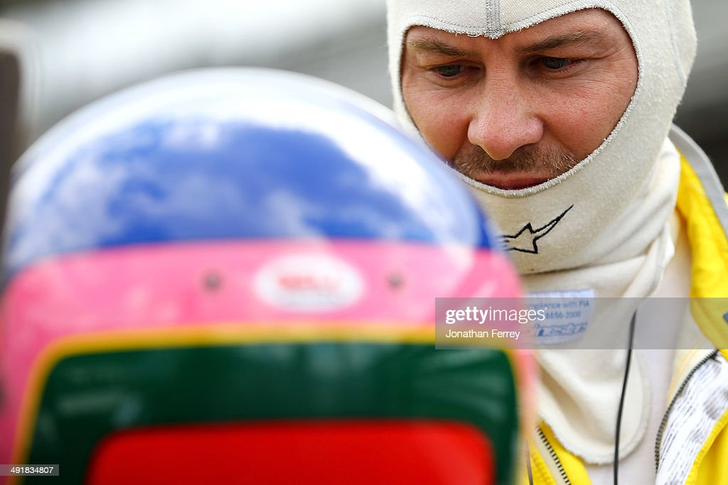 <a gi-track='captionPersonalityLinkClicked' href=/galleries/search?phrase=Jacques+Villeneuve&family=editorial&specificpeople=198963 ng-click='$event.stopPropagation()'>Jacques Villeneuve</a> of Canada, driver of the #5 Dollar General Schmidt Peterson Motorsports Honda Dallara waits to qualify for the 98th Indianapolis 500 Mile Race on May 17, 2014 at the Indianapolis Motor Speedway in Indianapolis, Indiana.